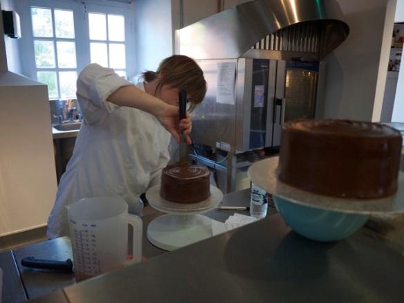 Sasha showing her tekkers on the cake wheel.