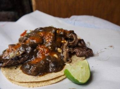 Steak taco, with mole sauce.